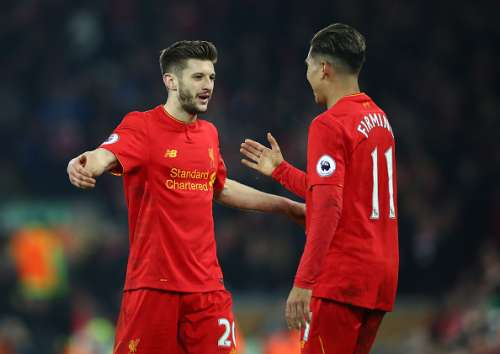 LIVERPOOL, ENGLAND - FEBRUARY 11: Adam Lallana of Liverpool celebrates with Roberto Firmino after the Premier League match between Liverpool and Tottenham Hotspur at Anfield on February 11, 2017 in Liverpool, England.  (Photo by Clive Brunskill/Getty Images)