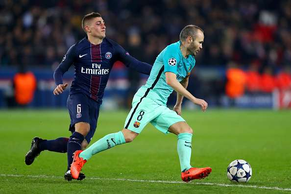 PARIS, FRANCE - FEBRUARY 14:  Andres Iniesta of Barcelona battles for the ball with Marco Verratti of Paris Saint-Germain during the UEFA Champions League Round of 16 first leg match between Paris Saint-Germain and FC Barcelona at Parc des Princes on February 14, 2017 in Paris, France.  (Photo by Clive Rose/Getty Images)