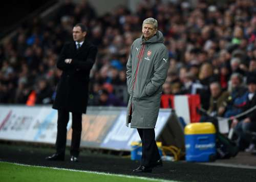 SWANSEA, WALES - JANUARY 14:  Arsene Wenger, Manager of Arsenal during the Premier League match between Swansea City and Arsenal at Liberty Stadium on January 14, 2017 in Swansea, Wales.  (Photo by Tony Marshall/Getty Images)
