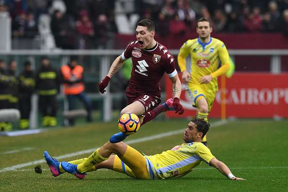 TURIN, ITALY - FEBRUARY 12:  Andrea Belotti (L) of FC Torino is tackled by Guglielmo Stendardo of Pescara Calcio during the Serie A match between FC Torino and Pescara Calcio at Stadio Olimpico di Torino on February 12, 2017 in Turin, Italy.  (Photo by Valerio Pennicino/Getty Images)