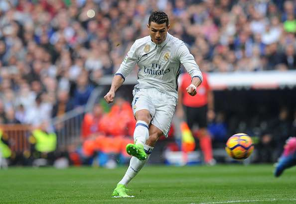 MADRID, SPAIN - FEBRUARY 18:  Cristiano Ronaldo of Real Madrid takes a free kick during the La Liga match between Real Madrid CF and RCD Espanyol at the Bernabeu stadium on February 18, 2017 in Madrid, Spain.  (Photo by Denis Doyle/Getty Images)