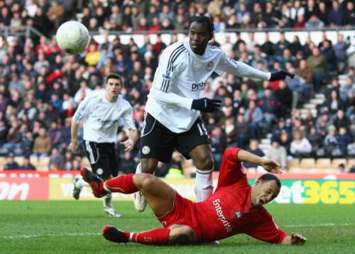 DERBY, UNITED KINGDOM - JANUARY 26:  Karl Hawley of Preston North End falls to the ground under the challenge of Claude Davis of Derby County during the E.ON sponsored FA Cup Fourth Round match between  Derby County and Preston North End at Pride Park on January 26, 2008 in Derby, England. (Photo by Laurence Griffiths/Getty Images)