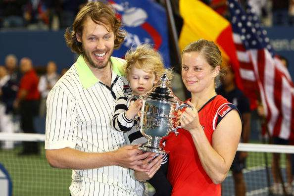 NEW YORK - SEPTEMBER 13:  Kim Clijsters of Belgium poses with the championship trophy alongside husband Brian Lynch and daughter Jada after defeating Caroline Wozniacki of Denmark in the Womens Singles final on day fourteen of the 2009 U.S. Open at the USTA Billie Jean King National Tennis Center on September 13, 2009 in the Flushing neighborhood of the Queens borough of New York City. Clijsters defeated Wozniacki 7-5, 6-3.  (Photo by Julian Finney/Getty Images)