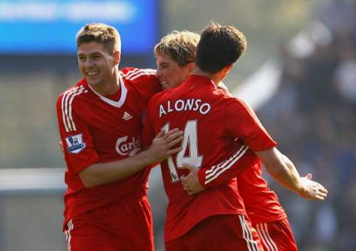 LIVERPOOL, UNITED KINGDOM - SEPTEMBER 27:  Fernando Torres of Liverpool celebrates with Steven Gerrard and Xabi Alonso after scoring his second goal during the Barclays Premier League match between Everton and Liverpool at Goodison Park on September 27, 2008 in Liverpool, England.  (Photo by Alex Livesey/Getty Images)