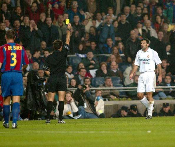 BARCELONA - NOVEMBER 23:  Luis Figo of Real Madrid is booked during the La Liga match between FC Barcelona and Real Madrid played at the Nou Camp Stadium, Barcelona, Spain on November 23, 2002. (Photo by Firo Foto/Getty Images)