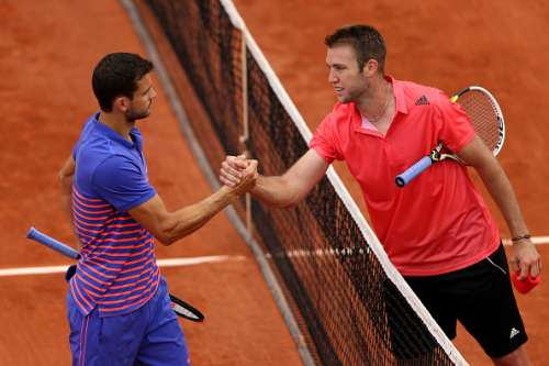 PARIS, FRANCE - MAY 26:  Jack Sock of the United States is congratulated on victory at the net by Grigor Dimitrov of Bulgaria after their Men's Singles match on day three of the 2015 French Open at Roland Garros on May 26, 2015 in Paris, France.  (Photo by Clive Brunskill/Getty Images)