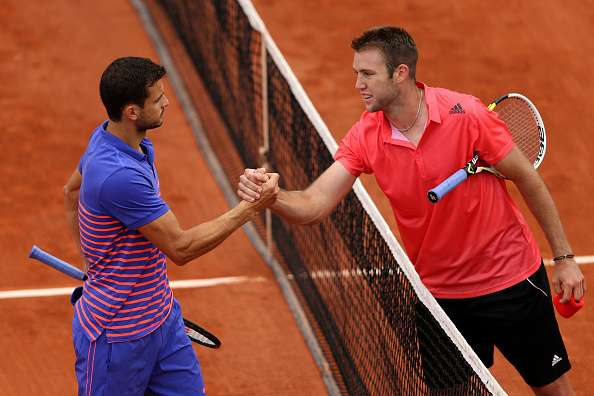 PARIS, FRANCE - MAY 26:  Jack Sock of the United States is congratulated on victory at the net by Grigor Dimitrov of Bulgaria after their Men
