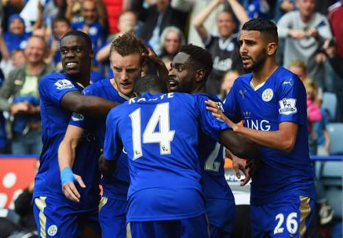 LEICESTER, ENGLAND - SEPTEMBER 13:  Jamie Vardy of Leicester City (2L) celebrates with team mates as he scores their second and equalising goal during the Barclays Premier League match between Leicester City and Aston Villa at the King Power Stadium on September 13, 2015 in Leicester, United Kingdom.  (Photo by Michael Regan/Getty Images)