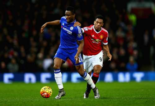 MANCHESTER, ENGLAND - DECEMBER 28:  John Obi Mikel of Chelsea holds off a challenge from Anthony Martial of Manchester United during the Barclays Premier League match between Manchester United and Chelsea at Old Trafford on December 28, 2015 in Manchester, England.  (Photo by Clive Mason/Getty Images)