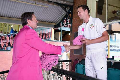 SYDNEY, AUSTRALIA - JANUARY 05: Josh Hazlewood of Australia presents former Australian bowler Glenn McGrath with his Pink Cap on Jane McGrath Day during day three of the third Test match between Australia and the West Indies at Sydney Cricket Ground on January 5, 2016 in Sydney, Australia.  (Photo by Cameron Spencer/Getty Images)