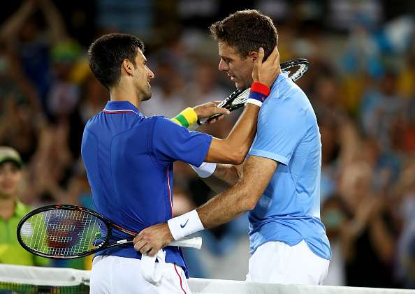 RIO DE JANEIRO, BRAZIL - AUGUST 07:  Juan Martin Del Potro of Argentina is congratulated by Novak Djokovic of Serbia after his victory in their singles match on Day 2 of the Rio 2016 Olympic Games at the Olympic Tennis Centre on August 7, 2016 in Rio de Janeiro, Brazil.  (Photo by Clive Brunskill/Getty Images)