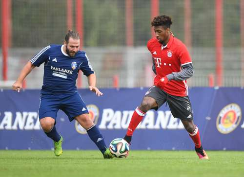 MUNICH, GERMANY - OCTOBER 12: Kingsley Coman (R) of FC Bayern Muenchen challenges Michael Oberli of the Paulaner Soccer Team during the Paulaner Fan Dream - Bavarian Battle Qualifier on October 12, 2016 in Munich, Germany.  (Photo by Lennart Preiss/Getty Images For Paulaner)
