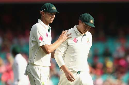 SYDNEY, AUSTRALIA - JANUARY 05:  Josh Hazlewood of Australia comforts Matt Renshaw of Australia as he leaves the field after being struck on the helmet while fielding during day three of the Third Test match between Australia and Pakistan at Sydney Cricket Ground on January 5, 2017 in Sydney, Australia.  (Photo by Mark Kolbe/Getty Images)