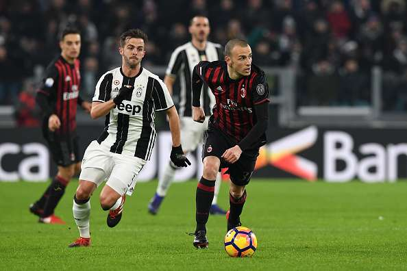TURIN, ITALY - JANUARY 25:  Luca Antonelli (R) of AC Milan in action against Miralem Pjanic of Juventus FC during the TIM Cup match between Juventus FC and AC Milan at Juventus Stadium on January 25, 2017 in Turin, Italy.  (Photo by Valerio Pennicino/Getty Images)