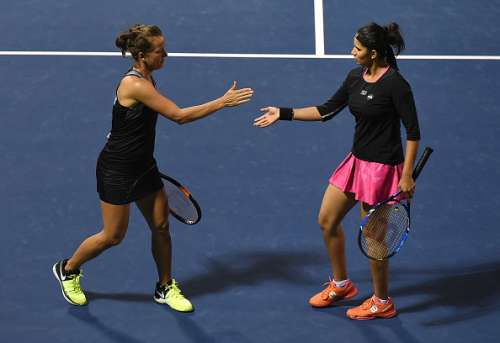 DUBAI, UNITED ARAB EMIRATES - FEBRUARY 23:  Sania Mirza of India and Barbora Strycova of Czech Republic celebrate a point during their match against Abigail Spears of United States and Katarina Srebotnik of Slovakia on day five of the WTA Dubai Duty Free Tennis Championship at the Dubai Tennis Stadium on February 23, 2017 in Dubai, United Arab Emirates.  (Photo by Tom Dulat/Getty Images)