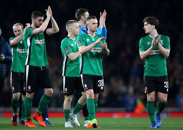 LONDON, ENGLAND - MARCH 11:  Lincoln City players applaud supporters after the full time whistle following defeat in The Emirates FA Cup Quarter-Final match between Arsenal and Lincoln City at Emirates Stadium on March 11, 2017 in London, England.  (Photo by Julian Finney/Getty Images)