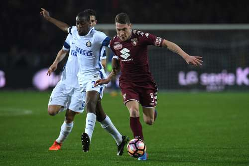 TURIN, ITALY - MARCH 18:  Andrea Belotti (R) of FC Torino is challenged by Geoffrey Kondogbia of FC Internazionale during the Serie A match between FC Torino and FC Internazionale at Stadio Olimpico di Torino on March 18, 2017 in Turin, Italy.  (Photo by Valerio Pennicino/Getty Images)