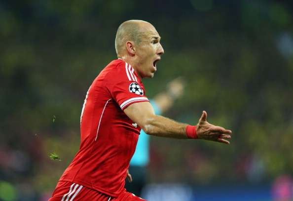 LONDON, ENGLAND - MAY 25:  Arjen Robben of Bayern Muenchen celebrates as he scores their second goal during the UEFA Champions League final match between Borussia Dortmund and FC Bayern Muenchen at Wembley Stadium on May 25, 2013 in London, United Kingdom.  (Photo by Alex Livesey/Getty Images)
