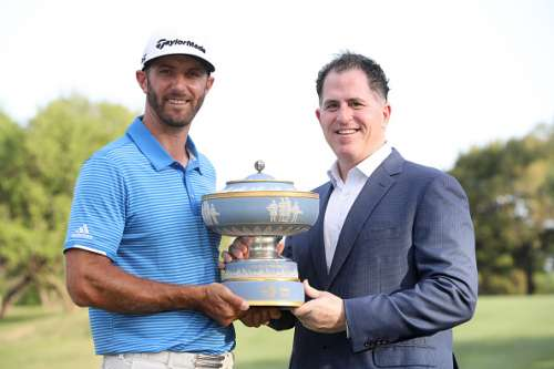 AUSTIN, TX - MARCH 26: Dustin Johnson (L) and the CEO of Dell Michael Dell pose with the trophy after the World Golf Championships-Dell Technologies Match Play at the Austin Country Club on March 26, 2017 in Austin, Texas. (Photo by Christian Petersen/Getty Images)