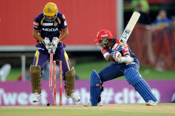 PRETORIA, SOUTH AFRCA - OCTOBER 13:  Mahela Jayawardene of the Daredevils is bowled by Sunil Narine (not pictured) as wicketkeeper Manvinder Bisla (L) of the Knight Riders reacts during the Karbonn Smart CLT20 Group A match between Kolkata Knight Riders (IPL) and Delhi Daredevils (IPL) at SuperSport Park on October 13, 2012 in Pretoria, South Africa.  (Photo by Lee Warren/Gallo Images/Getty Images)