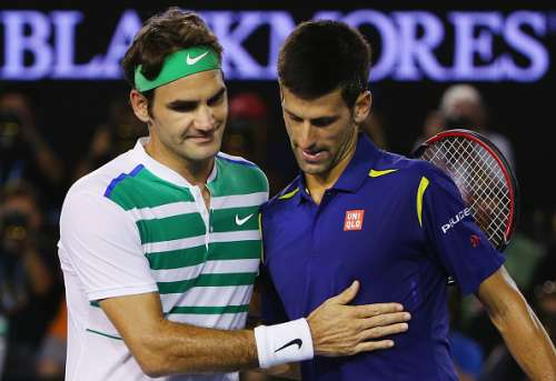 MELBOURNE, AUSTRALIA - JANUARY 28:  Novak Djokovic of Serbia is congratulated after winning in his semi final match against Roger Federer (L) of Switzerland during day 11 of the 2016 Australian Open at Melbourne Park on January 28, 2016 in Melbourne, Australia.  (Photo by Michael Dodge/Getty Images)
