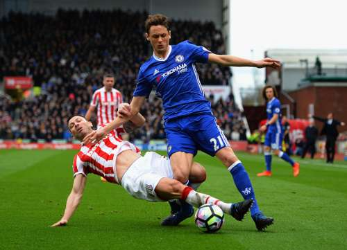 STOKE ON TRENT, ENGLAND - MARCH 18:  Phil Bardsley of Stoke City tackles  Nemanja Matic of Chelsea during the Premier League match between Stoke City and Chelsea at Bet365 Stadium on March 18, 2017 in Stoke on Trent, England.  (Photo by Tony Marshall/Getty Images)