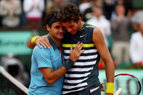 PARIS - JUNE 05:  Roger Federer (L) of Switzerland  is congratulated by Juan Martin Del Potro of Argentina following his victory during the Men's Singles Semi Final matchon day thirteen of the French Open at Roland Garros on June 5, 2009 in Paris, France.  (Photo by Clive Brunskill/Getty Images)