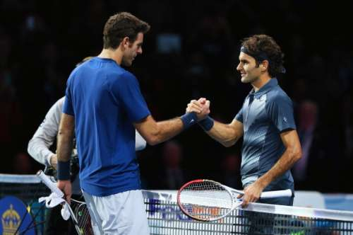 LONDON, ENGLAND - NOVEMBER 09:  Roger Federer of Switzerland shakes hands with Juan Martin Del Potro of Argentina after Federer won the match during day six of the Barclays ATP World Tour Finals at O2 Arena on November 9, 2013 in London, England.  (Photo by Clive Brunskill/Getty Images)