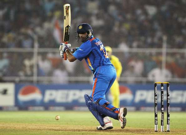 AHMEDABAD, INDIA - MARCH 24:  Yuvraj Singh of India hits the ball towards the boundary during the 2011 ICC World Cup Quarter Final match between Australia and India at Sardar Patel Stadium on March 24, 2011 in Ahmedabad, India.  (Photo by Matthew Lewis/Getty Images)