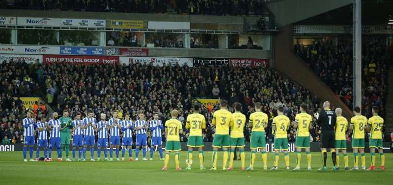 Britain Football Soccer - Norwich City v Brighton & Hove Albion - Sky Bet Championship - Carrow Road - 21/4/17 Players during a minutes applause in memory of former footballer Ugo Ehiogu before the match Action Images via Reuters / Andrew Couldridge