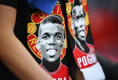 MANCHESTER, ENGLAND - AUGUST 19: An image of Paul Pogba of Manchester United appears on a scarf prior to the Premier League match between Manchester United and Southampton at Old Trafford on August 19, 2016 in Manchester, England.  (Photo by Michael Regan/Getty Images)