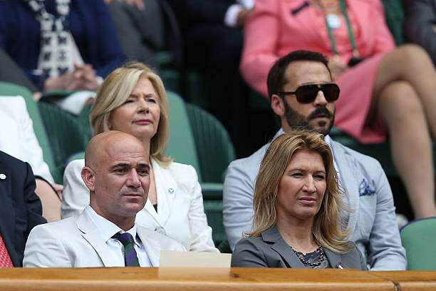 LONDON, ENGLAND - JULY 04:  Andre Agassi and Stefanie Graf look on from the Royal Box on Centre Court during day nine of the Wimbledon Lawn Tennis Championships at the All England Lawn Tennis and Croquet Club on July 4, 2012 in London, England.  (Photo by Clive Rose/Getty Images)