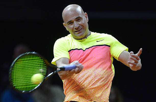 STUTTGART, GERMANY - APRIL 20:  Andre Agassi of the USA in action during his Berenberg Classic match against Thomas Muster of Austria on day one of the Porsche Tennis Grand Prix at Porsche-Arena on April 20, 2015 in Stuttgart, Germany.  (Photo by Daniel Kopatsch/Getty Images)