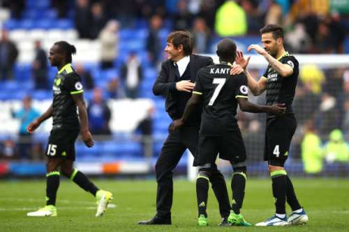 LIVERPOOL, ENGLAND - APRIL 30: Antonio Conte, Manager of Chelsea celebrates with N'Golo Kante of Chelsea and Cesc Fabregas of Chelsea during the Premier League match between Everton and Chelsea at Goodison Park on April 30, 2017 in Liverpool, England.  (Photo by Clive Brunskill/Getty Images)