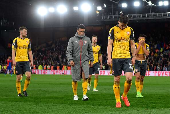 Arsenal players are dejected after the loss against Crystal Palace