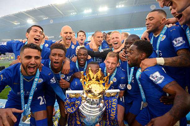 LEICESTER, ENGLAND - MAY 07:  Captain Wes Morgan of Leicester City to lift the Premier League Trophy as players celebrate the season champions after the Barclays Premier League match between Leicester City and Everton at The King Power Stadium on May 7, 2016 in Leicester, United Kingdom.  (Photo by Michael Regan/Getty Images)