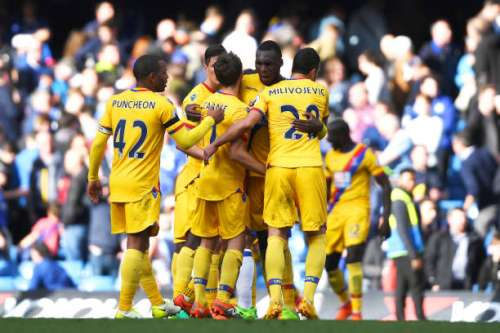 LONDON, ENGLAND - APRIL 01: Christian Benteke of Crystal Palace celebrates scoring his sides second goal with his Crystal Palace team mates during the Premier League match between Chelsea and Crystal Palace at Stamford Bridge on April 1, 2017 in London, England.  (Photo by Mike Hewitt/Getty Images)
