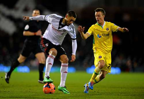 LONDON, ENGLAND - FEBRUARY 04:  Clint Dempsey of Fulham ais marshalled by Stefan Scougall of Sheffield United during the FA Cup Fourth Round Replay match between Fulham and Sheffield United at Craven Cottage on February 4, 2014 in London, England.  (Photo by Christopher Lee/Getty Images)