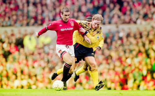 MANCHESTER, UNITED KINGDOM - APRIL 28:  Eric Cantona of  Manchester United holds off the challenge of Scott Gemmill of Forest during an FA Carling Premiership match against Nottingham Forest at Old Trafford on April 28, 1996 in Manchester, England,  Manchester United won the match 5-0  (Photo by Shaun Botterill/Allsport/Getty Images)
