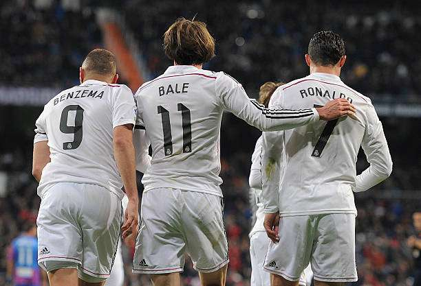 MADRID, SPAIN - MARCH 15:  Gareth Bale of Real Madrid celebrates with Cristiano Ronaldo and Karim Benzema  after scoring Real
