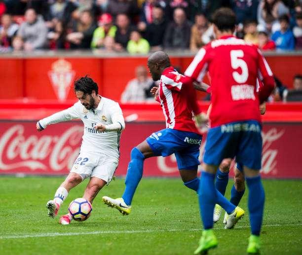 GIJON, SPAIN - APRIL 15:  Isco of Real Madrid scoring his team