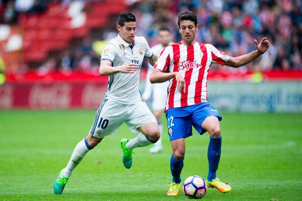 GIJON, SPAIN - APRIL 15:  James Rodriguez of Real Madrid duels for the ball with Mikel Vesga of Real Sporting de Gijon during the La Liga match between Real Sporting de Gijon and Real Madrid at Estadio El Molinon on April 15, 2017 in Gijon, Spain.  (Photo by Juan Manuel Serrano Arce/Getty Images)