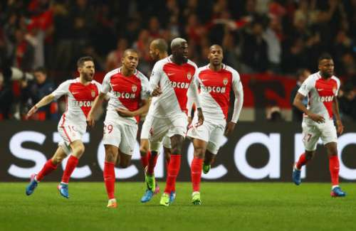 MONACO - MARCH 15:  Kylian Mbappe of AS Monaco (29) celebrates as he scores their first goal with team mates during the UEFA Champions League Round of 16 second leg match between AS Monaco and Manchester City FC at Stade Louis II on March 15, 2017 in Monaco, Monaco.  (Photo by Michael Steele/Getty Images)