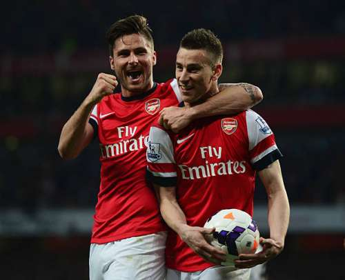 LONDON, ENGLAND - APRIL 28:  Laurent Koscielny of Arsenal celebrates wth Olivier Giroud (L) as he scores their first goal during the Barclays Premier League match between Arsenal and Newcastle United at Emirates Stadium on April 28, 2014 in London, England.  (Photo by Jamie McDonald/Getty Images)