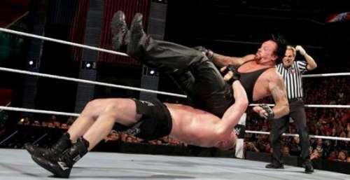 Brock Lesnar suplexing The Undertaker