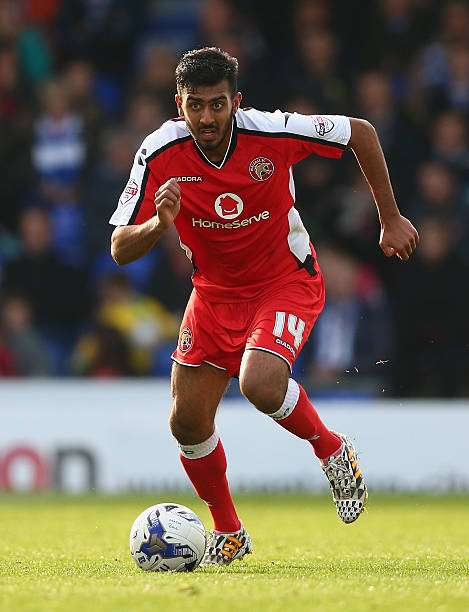 OLDHAM, ENGLAND - OCTOBER 11:  Malvind Benning of Walsall in action during the Sky Bet League One match between Oldham Athletic and Walsall at Boundary Park on October 11, 2014 in Oldham, England.  (Photo by Clive Brunskill/Getty Images)