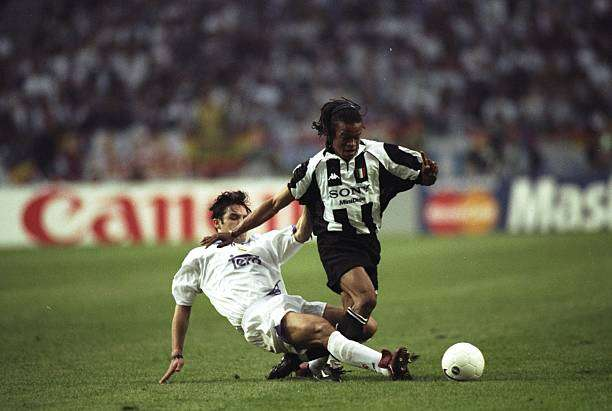 20 May 1998:  Edgar Davids of Juventus is tackled by Fernando Morientes of Real Madrid during the Champions League final at the Amsterdam Arena in Holland. Real Madrid won the match 1-0. \ Mandatory Credit: Shaun  Botterill/Allsport