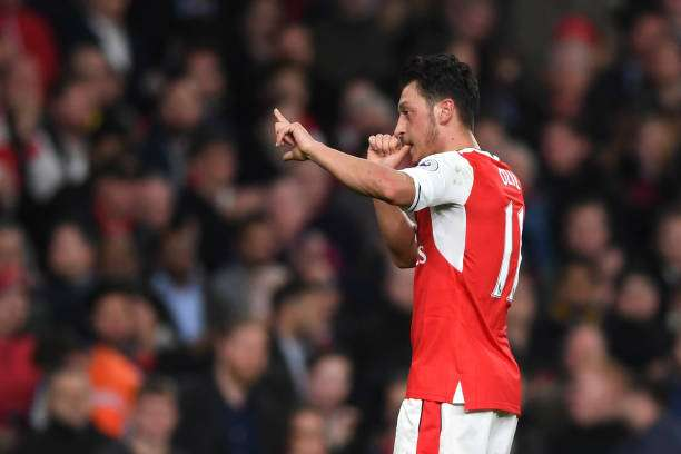LONDON, ENGLAND - APRIL 05:  Mesut Ozil of Arsenal celebrates scoring his sides first goal during the Premier League match between Arsenal and West Ham United at the Emirates Stadium on April 5, 2017 in London, England.  (Photo by Shaun Botterill/Getty Images,)