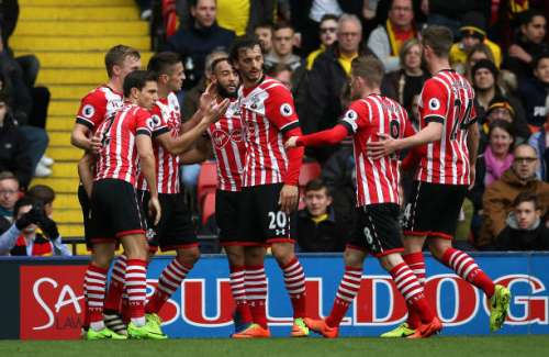 WATFORD, ENGLAND - MARCH 04: Nathan Redmond of Southampton (C) celebrates scoring his sides second goal with his Southampton team mates during the Premier League match between Watford and Southampton at Vicarage Road on March 4, 2017 in Watford, England.  (Photo by Steve Bardens/Getty Images)