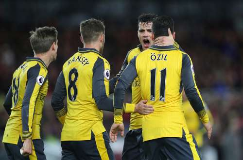 Arsenal players celebrate during the game
